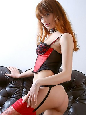 Oh so sexy Kristina poses seductively in black and red lingerie.